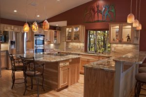 A luxury remodeled kitchen with granite countertops and stainless steel appliances